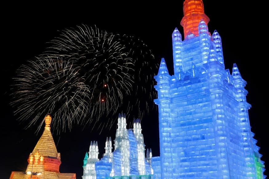 11. చైనాలో హార్బిన్ ఐస్ అండ్ స్నో ఫెస్టివల్లో మంచు శిల్పాలు, కళాఖండాలు, భవనాలపై బాణా సంచా పేలుళ్లు. (Image: Reuters)