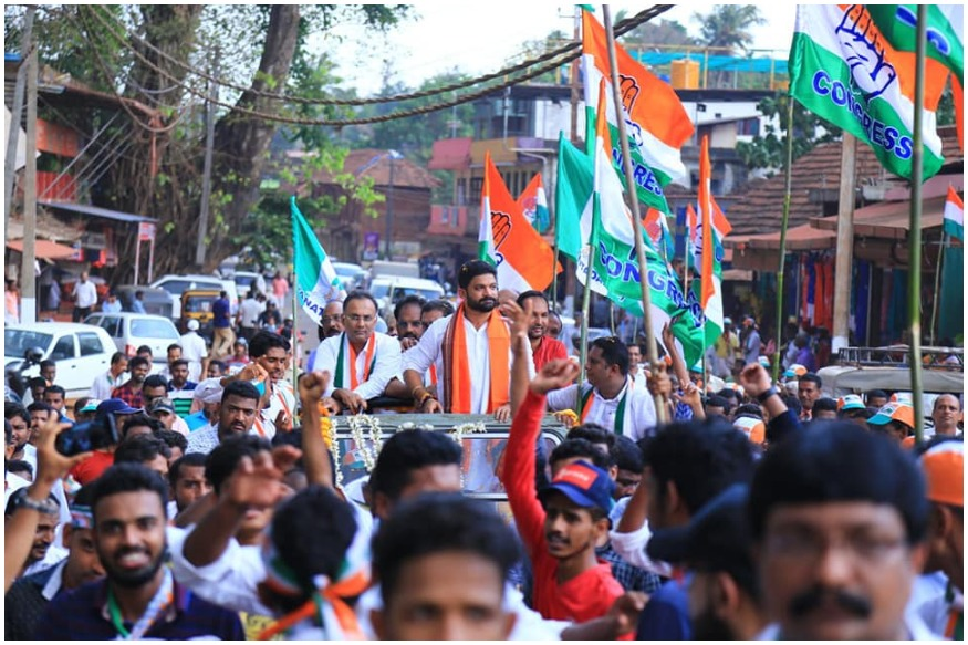 కాషాయ కండువాలతో ప్రచారం చేస్తున్న కాంగ్రెస్ అభ్యర్థి మిథున్ (Image : Facebook)